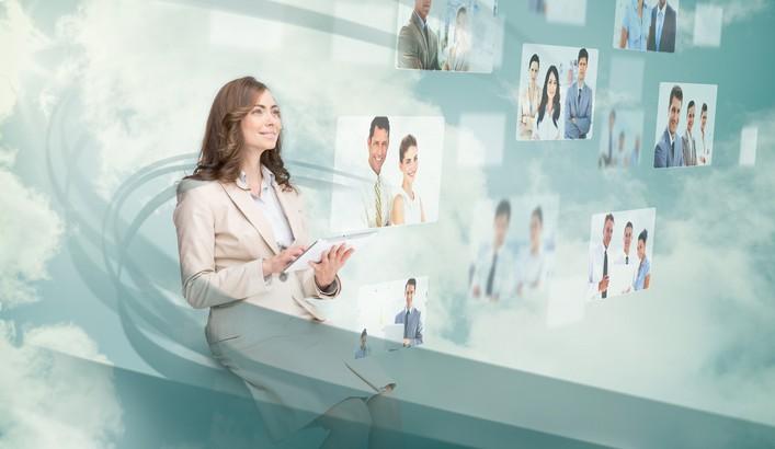Smiling businesswoman using digital interface