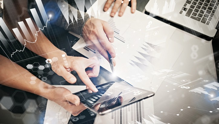 Photo female hands holding modern tablet and touching screen.Businessmans