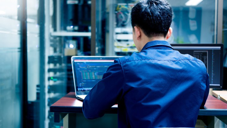 Young IT engineer working at server room is Multi Display, Data Protection Security Privacy Concept.